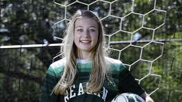 Reagan soccer and track star Taylor Olson poses in 2017.