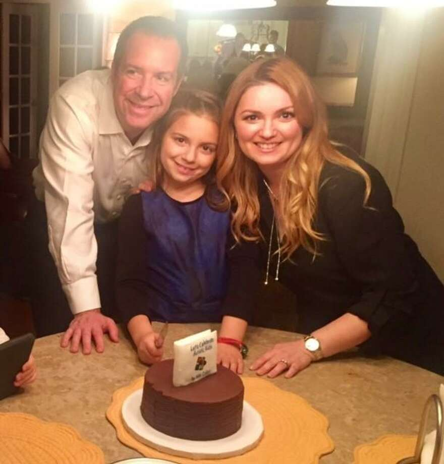 Mia Callot with her parents. Photo: Contributed Photo