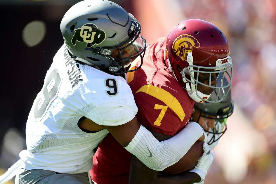 LOS ANGELES, CA - OCTOBER 08:  Steven Mitchell Jr. #7 of the USC Trojans is tackled by Tedric Thompson #9 of the Colorado Buffaloes during the second quarter at Los Angeles Memorial Coliseum on October 8, 2016 in Los Angeles, California.  (Photo by Harry How/Getty Images)