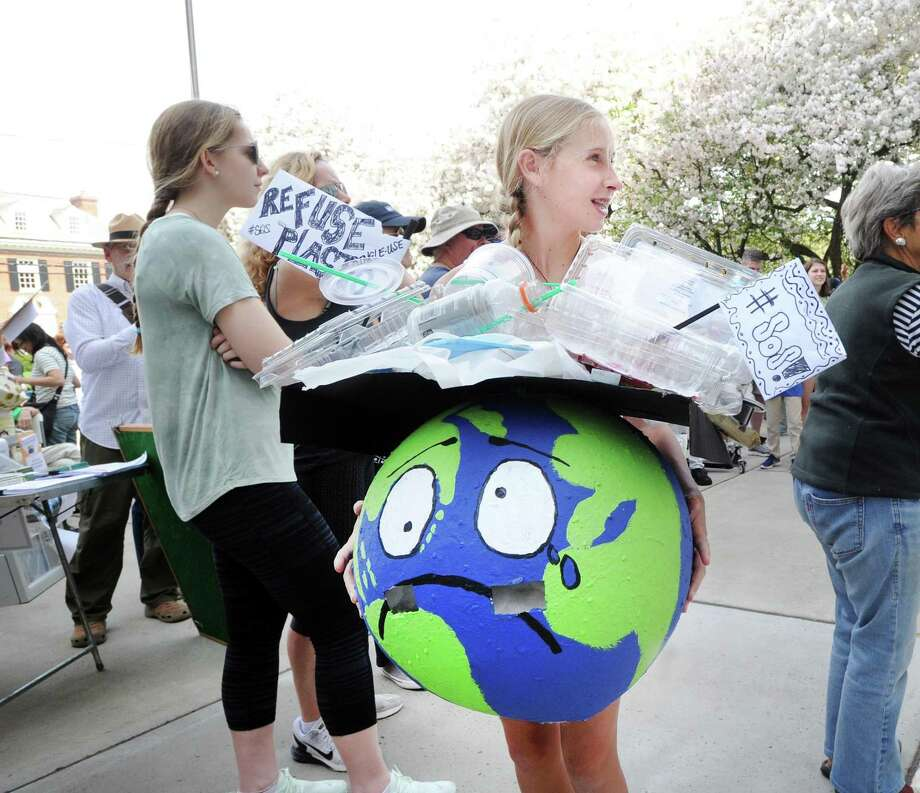 Milli Getz, 13, of Greenwich, wore a distressed Earth costume that she made during the Children's Environmental March at Greenwich Town Hall, Greenwich, Conn., Saturday morning, April 29, 2017. The gathering of the young environmentalists and their families coincided with the People's Climate March that was taking place in Washington, D.C. Photo: Bob Luckey Jr. / Hearst Connecticut Media / Greenwich Time