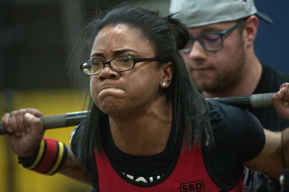 Ariel Crumes of Rochester Hills squats 314 pounds during the 2017 Spring Natural and Fit BarBellum powerlifting meet Saturday morning at Bullock Creek High School. Crumes broke the state record for the 63 kg open weight class. Photo: Brittney Lohmiller/Midland Daily News/Brittney Lohmiller