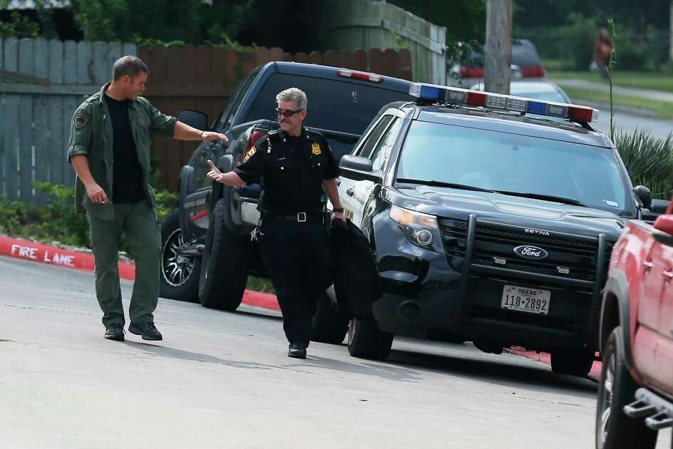 "Members of the negotiation team from the San Antonio Police Department exchange handshakes after concluding a hostage situation between a man and woman at The Crossings apartment complex off Babcock Road on Saturday, Apr. 29, 2017. The man entered the apartment of his ex-girfriend during the early morning hours on Friday and held her hostage when SAPD was called in to diffuse the situation. After hours of negotiating with the 29-year-old hostage taker, he released the woman and was peacefully taken into custody. Sgt. Jesse Salame, PIO with SAPD, said the man is waiting to be charged and will face charges including: aggravated kidnapping, possibly felony possession of firearm and assault. ""This was the ideal situation. It took eight hours but we're happy that it was resolved peacefully,"" Salame said."