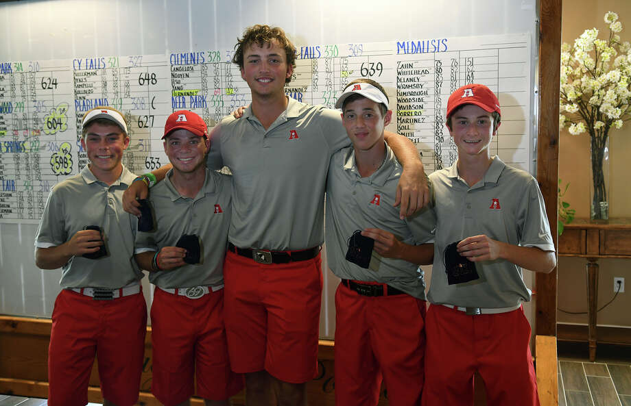 The Atascocita boys golf team, including senior Andrew Bohli, from left, senior Brennan Deslatte, junior Ransom Jacobson, junior Theo Marules, and freshman Cam Latto show off their third place medals that qualify them for the state tournament at the Region III-6A Boys Golf Championships at Eagle Pointe Golf Club in Mont Belvieu on Thursday, April 27, 2017. (Photo by Jerry Baker/Freelance) Photo: Jerry Baker, Freelance / Freelance