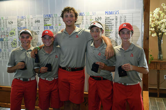 The Atascocita boys golf team, including senior Andrew Bohli, from left, senior Brennan Deslatte, junior Ransom Jacobson, junior Theo Marules, and freshman Cam Latto show off their third place medals that qualify them for the state tournament at the Region III-6A Boys Golf Championships at Eagle Pointe Golf Club in Mont Belvieu on Thursday, April 27, 2017. (Photo by Jerry Baker/Freelance)