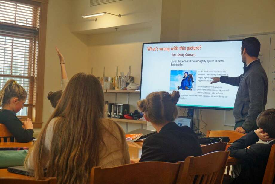 Greenwich Country Day seventh graders listen in to a lesson on fake news by technology teacher Sam Rosenfeld. Photo: Emilie Munson