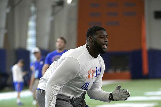 Offensive lineman David Sharpe (78) runs through a drill during Florida's NFL Pro Day in Gainesville, Fla., Tuesday, March 28, 2017. (AP Photo/Phelan M. Ebenhack)