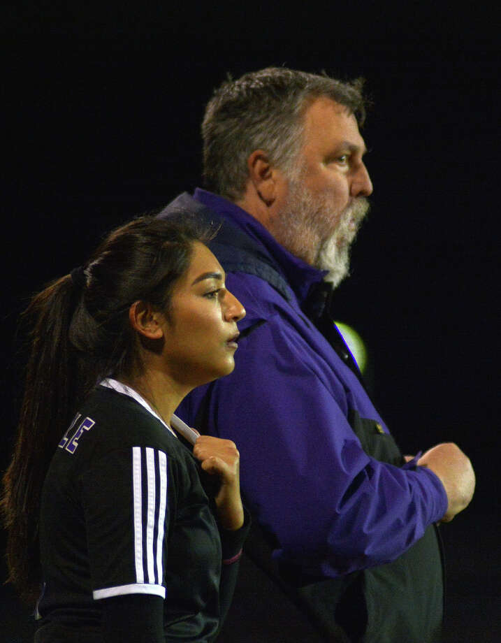 Humble's Denisse Castellanos, left, and head coach Scott East watch the their team work against Porter during a District 21-5A matchup at Porter High School on Feb. 3, 2017. (Photo by Jerry Baker/Freelance) Photo: Jerry Baker, Freelance / Freelance