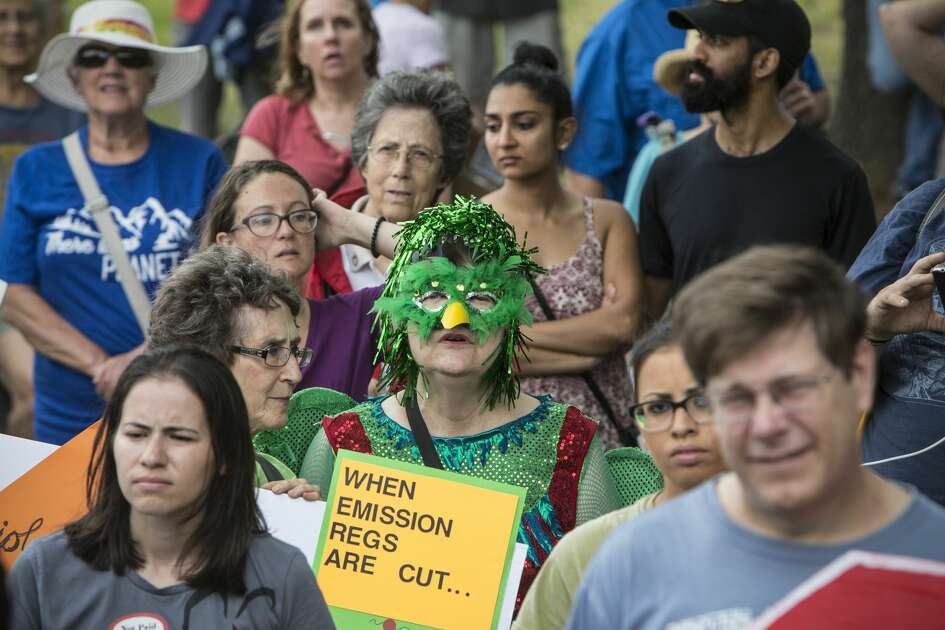 Demonstrators listen to speakers during the Houston Climate March rally at Clinton Park on Saturday, April 29, 2017, in Houston. ( Brett Coomer / Houston Chronicle )