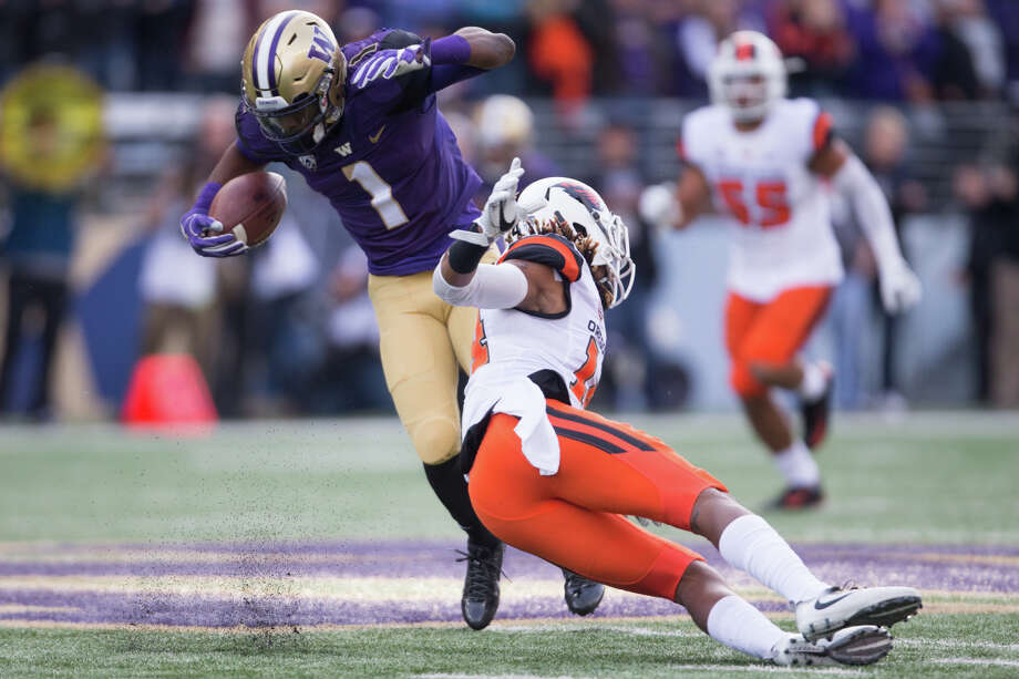 Washington wide receiver John Ross avoids a tackle by Oregon State cornerback Treston Decoud in the first half of an NCAA football game at Husky Stadium on Saturday, Oct. 22, 2016. Photo: GRANT HINDSLEY, SEATTLEPI.COM / SEATTLEPI.COM