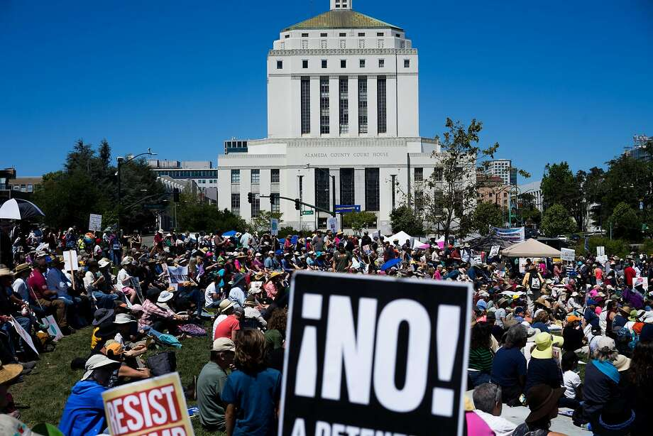 People gather at Lake Merritt to protest President Trump's record on the environment in Oakland, Calif. on Saturday, April 29, 2017. Environmental activists gathered as part of a nationwide series of marches to challenge President Trump's environmental record. Photo: James Tensuan, Special To The Chronicle