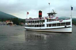 TIMES UNION PHOTO BY: LUANNE M. FERRIS--Thursday, June 26, 2008, Lake George, NY,  View from shore looking at Lake George, NY, on Thursday, June 26, 2008, as the Mohican, one of the liners from the Lake George Steamboat Co., decorated to mark it's 100th anniversary of safe sailing, sets out for a cruise.