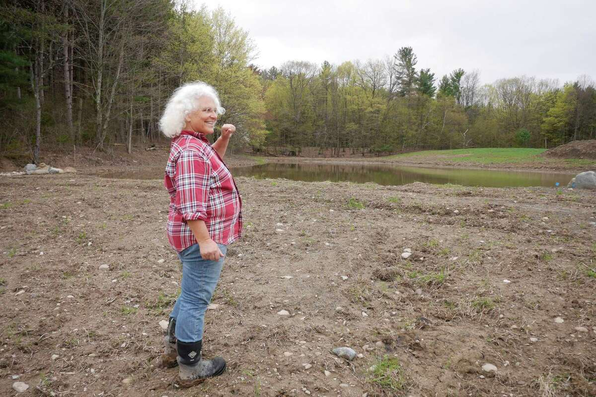 Rebekah Rice stands on the bank of her second farm irrigation pond at 9 Mile Farm on Thursday, April 27, 2017, in Delmar, N.Y. Last summer her original irrigation pond on the property ran down where the farm had no running water. (Paul Buckowski / Times Union)