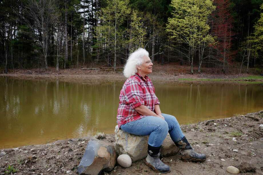 Rebekah Rice sits on the bank of her second farm irrigation pond at 9 Mile Farm on Thursday, April 27, 2017, in Delmar, N.Y.  Last summer her original irrigation pond on the property ran down where the farm had no running water.   (Paul Buckowski / Times Union) Photo: PAUL BUCKOWSKI / 20040363A