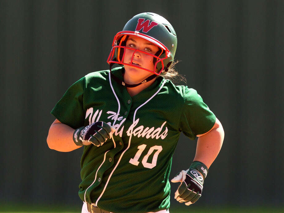Kelcy Leach of The Woodlands rounds the base after hitting a two-run home run off Liberty pitcher Sarah Lopez during the third inning of a high school softball game at The Woodlands Varsity Round Robin Invitational at The Woodlands High School Friday, Feb. 24, 2017, in The Woodlands. Photo: Jason Fochtman, Staff Photographer / © 2017 Houston Chronicle