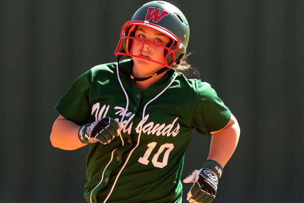 Kelcy Leach of The Woodlands rounds the base after hitting a two-run home run off Liberty pitcher Sarah Lopez during the third inning of a high school softball game at The Woodlands Varsity Round Robin Invitational at The Woodlands High School Friday, Feb. 24, 2017, in The Woodlands.