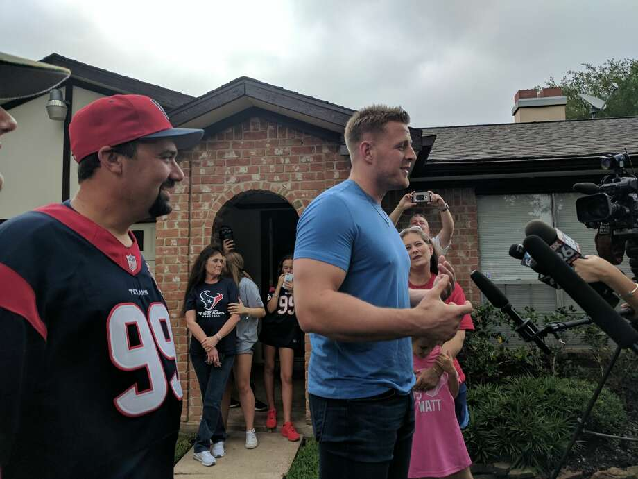 Houston Texans defensive end J.J. Watt personally delivered a pizza to a super-fan, Houstonian Wayne Lominac, at his Ellington-area home on Saturday afternoon as part of a Papa John's Houston contest. Photo: Emily Burleson/The Houston Chronicle