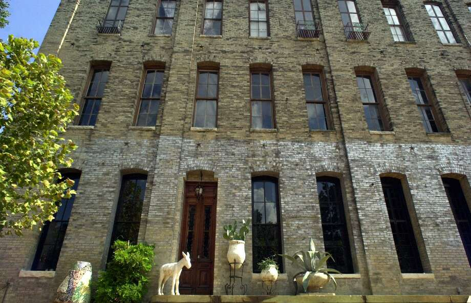 The building at 214 Regent St., formerly housed longtime businesses, the Lone Star Seed Co. and Voss Metal Works and has been a private residence since the mid-1990s Photo: San Antonio Express-News File Photo / EN
