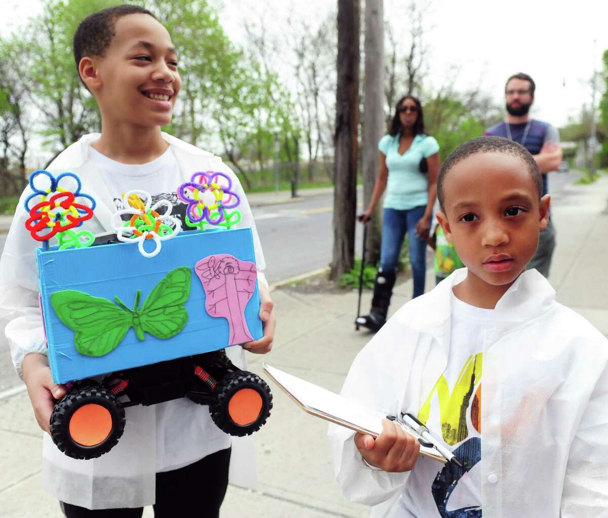 Daivion and Octavion Morris walk with a rover that detects air temperatures and small particles in Albany, N.Y. on April 29, 2017. (Robert Downen / Times Union)