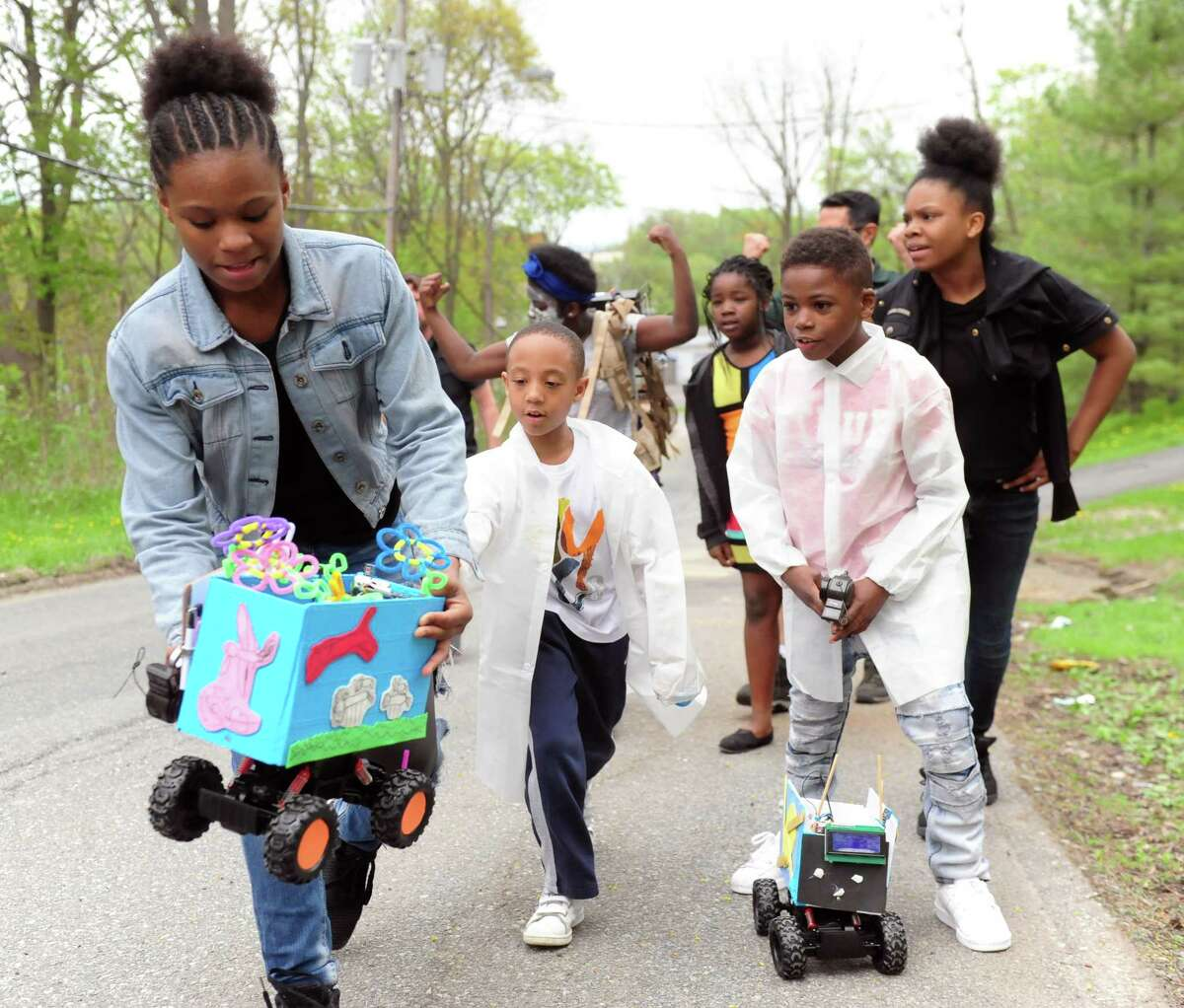 Kids walk with a rover that detects air temperatures and small particles in Albany, N.Y. on April 29, 2017. They were part of a program overseen by Rensselaer Polytechnic Institute that pairs science and art to get communities interested in local health initiatives. (Robert Downen / Times Union)