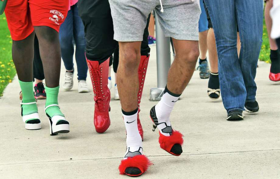 The tenth annual Walk a Mile in Her Shoes event starts out from Riverfront Park Saturday April 29, 2017 in Troy, NY.  (John Carl D'Annibale / Times Union) Photo: John Carl D'Annibale / 20040149A