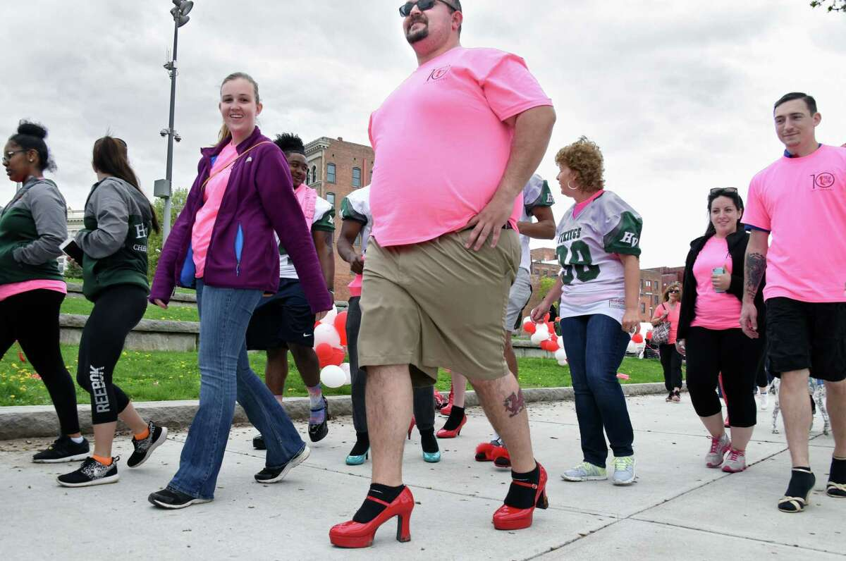 Andy Roberts, center, of Bennington, Vt., participates in the tenth annual Walk a Mile in Her Shoes event starts out from Riverfront Park Saturday April 29, 2017 in Troy, NY. (John Carl D'Annibale / Times Union)