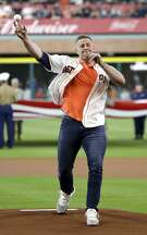 Houston Texans' J.J. Watt throws out the first pitch before a baseball game between the Oakland Athletics and the Houston Astros on Saturday, April 29, 2017, in Houston. (AP Photo/David J. Phillip)
