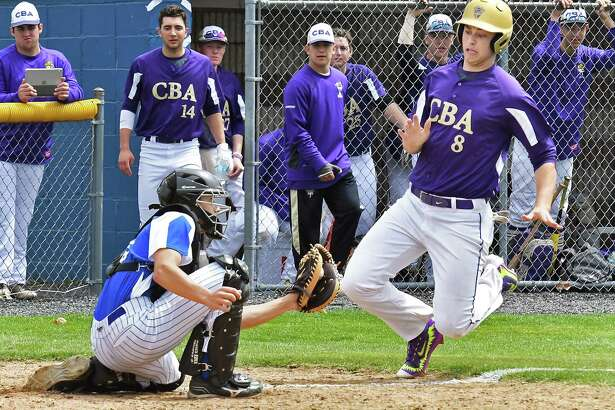 Shaker catcher #22 Joe Vonholten puts out Shaker base runner #8 Davis Payne at the plate during Thursday's game against CBA April 20, 2017 in Colonie, NY.  (John Carl D'Annibale / Times Union)