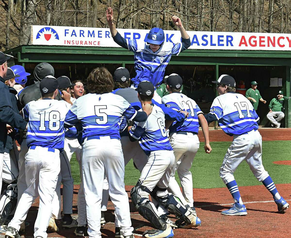 Saratoga's Brian Hart, #8, jumps onto home plate after hitting a game winning home run in extra innings during a baseball game against Shenendehowa as they play for the I-87 Cup on Friday, April 14, 2017 in Amsterdam, N.Y. (Lori Van Buren / Times Union)