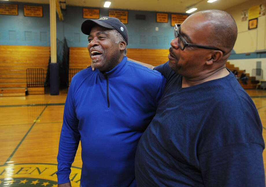 New Harding High boys basketball coach and former Harding star and NBA player John Bagley, left, has a laugh with his former teammate Keith Pierce at the school in Bridgeport, Conn. on Thursday, April 27, 2017. Photo: Brian A. Pounds / Hearst Connecticut Media / Connecticut Post