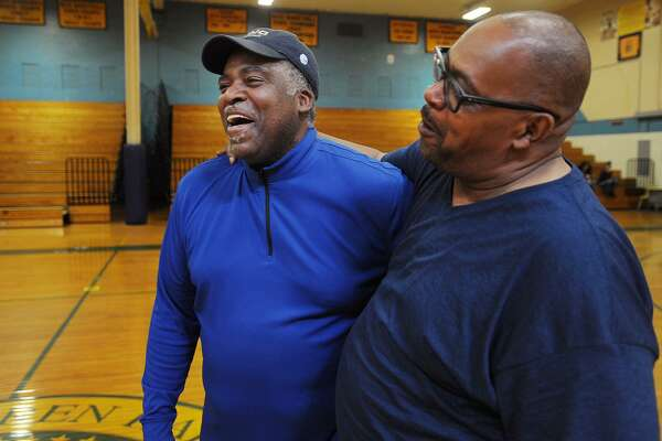 New Harding High boys basketball coach and former Harding star and NBA player John Bagley, left, has a laugh with his former teammate Keith Pierce at the school in Bridgeport, Conn. on Thursday, April 27, 2017.