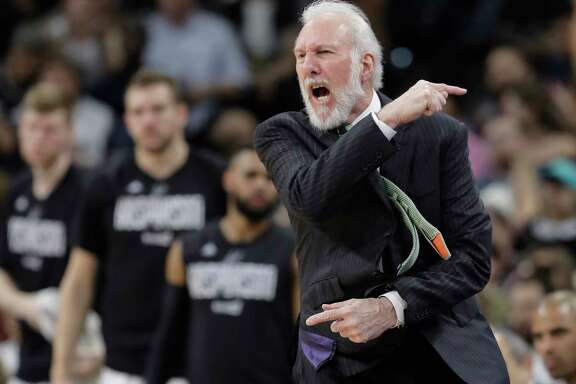 San Antonio Spurs head coach Gregg Popovich argues a call during the first half of Game 5 in a first-round NBA basketball playoff series against the Memphis Grizzlies, Tuesday, April 25, 2017, in San Antonio. (AP Photo/Eric Gay)