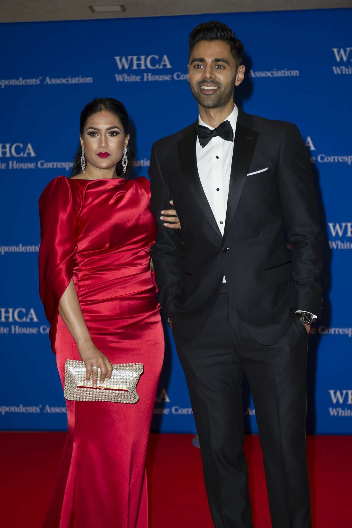 The Daily Show correspondent Hasan Minhaj and his wife Beena pose for a photograph as they arrive to attend the White House Correspondents' Dinner in Washington, Saturday, April 29, 2017. (AP Photo/Cliff Owen)