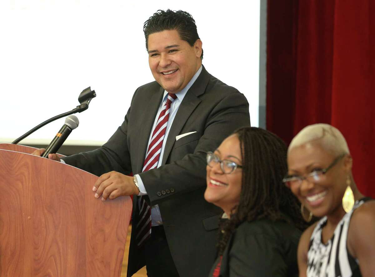 Richard Carranza, the Houston Independent School District's new superintendent, answers questions from the third ward community during a meeting at Blackshear Elementary School Saturday, Oct. 8, 2016, in Houston. Blackshear Elementary School Principal Alicia Lewis, left, and HISD trustee Jolanda Jones were also at the meeting. (Yi-Chin Lee / Houston Chronicle )