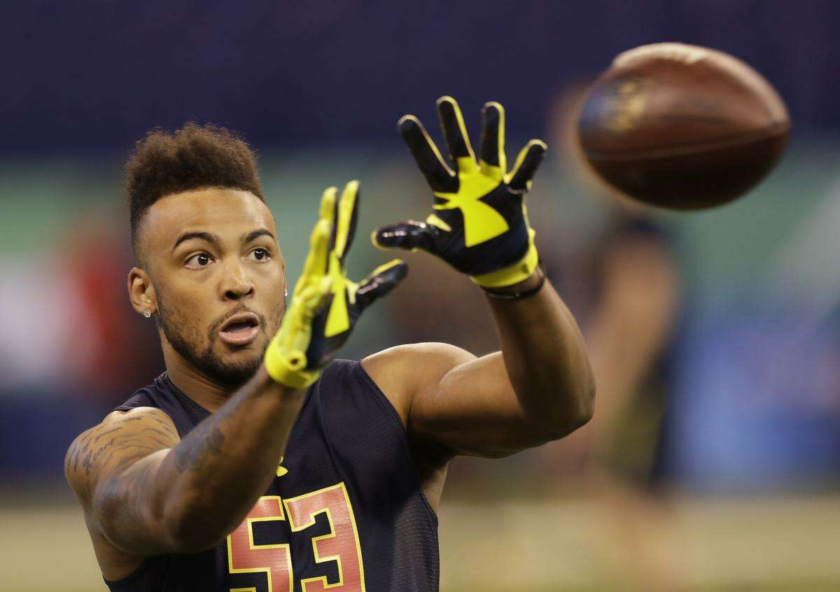 Connecticut wide receiver Noel Thomas runs a drill at the NFL football scouting combine Saturday, March 4, 2017, in Indianapolis. (AP Photo/David J. Phillip)