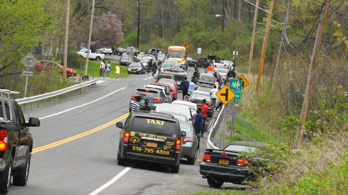 The road to Schodack Island State Park in Schodack Landing is clogged with traffic on Saturday, April 29, 2017, as police responded to alleged fights at an concert event called