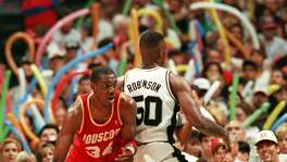 "FILE -- DREAM SHAKE -- Hakeem Olajuwon is pictured here doing the famous ""dream shake"" which caught David Robinson off guard during the playoffs at the Alamodome on 5/24/1995. SPRUS V. ROCKETS -- Photo by Doug Sehres / Staff"