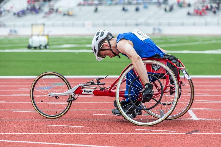 April 29, 2017:  CE King's Joseph Doak won the Varsity Boys Wheelchair 100 meter race during the Regional III Track meet at Challenger Stadium in Webster, Texas.  (Leslie Plaza Johnson/Freelance) Photo: Leslie Plaza Johnson/For The Chronicle