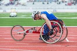 April 29, 2017:  CE KingJoseph Doak won the Varsity Boys Wheelchair 100 meter race during the Regional III Track meet at Challenger Stadium in Webster, Texas.  (Leslie Plaza Johnson/Freelance)