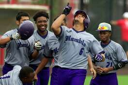 Alex Caballero #6 of Humble celebrates around teammates after hitting a solo home run off Porter pitcher Cole Godkin (6) during the fourth inning of a District 21-5A high school baseball playoff game, Saturday, April 29, 2017, in Crosby. Humble defeated Porter 3-0 to earn the district's fourth and final playoff spot.