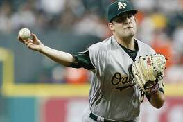 HOUSTON, TX - APRIL 29: Andrew Triggs #60 of the Oakland Athletics pitches in the first inning against the Houston Astros at Minute Maid Park on April 29, 2017 in Houston, Texas. (Photo by Bob Levey/Getty Images)