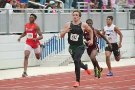 Clear Falls' Christopher Rainey competes in the 200M dash at the Region III Track Meet Saturday, Apr. 29 at CCISD Challenger Columbia Stadium.