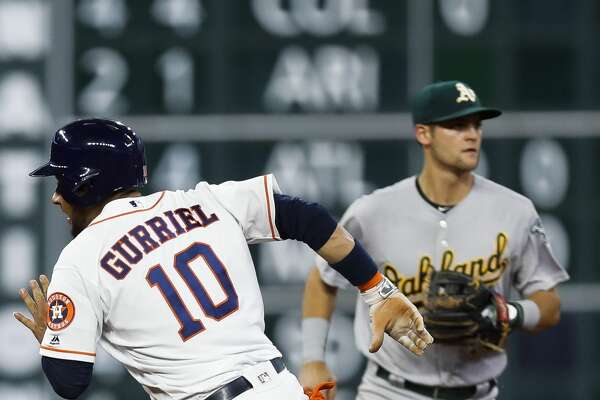 Houston Astros first baseman Yuli Gurriel (10) rounds second base and heads to third during the fourth inning as the Houston Astros take on the Oakland Athletics at Minute Maid Park Saturday, April 29, 2017 in Houston. ( Michael Ciaglo / Houston Chronicle)