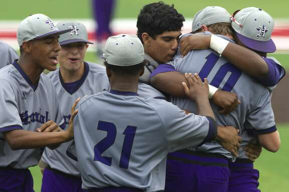 Humble celebrates after shutting out Porter 3-0 to earn the District 21-5A fourth and final playoff spot after high school baseball playoff game, Saturday, April 29, 2017, in Crosby.