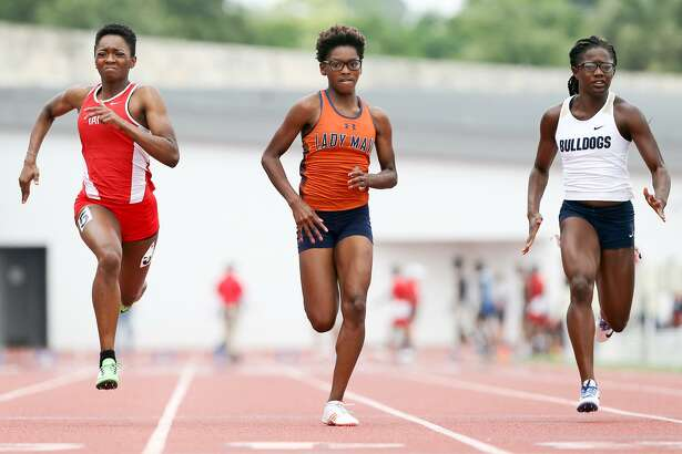 Madison's Breanna Ransom (center) approaches the finsih line of the 6A girls 100 meter dash ahead of Taft's Jade Neal (left) and Laredo Alexander's Cynthia Emeremnu during the Region IV-6A and Region IV-5A track and field championships at Alamo Stadium on April 29, 2017. ansom won the event with a time of 12.34 seconds.  Neal finished second.  MARVIN PFEIFFER/ mpfeiffer@express-news.net