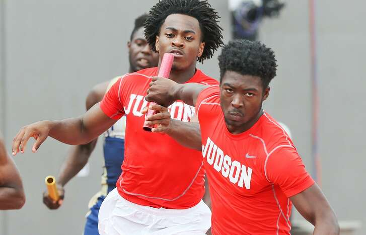 Judson's Shawn Richburg takes the handoff from Chris Mills to start the third leg of the 6A boys 800-meter relay during the Region IV track and field championships at Alamo Stadium on April 29, 2017. Judson swept the relays, winning the 800 with a new regional record time of 1:24.83.