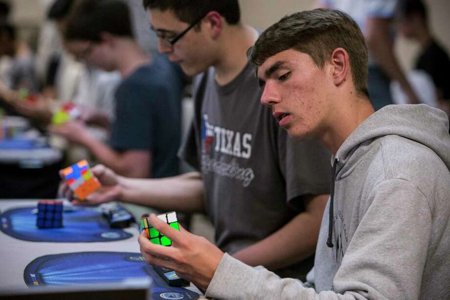 "Rocca Perciavalle competes in ""Don't Mess with Texas,"" a Rubik's Cube competition on Saturday at the Westin Galleria. Such contests for the decades-old puzzle are drawing greater numbers of competitors, especially in Texas. Photo: Brett Coomer, Staff / © 2017 Houston Chronicle"