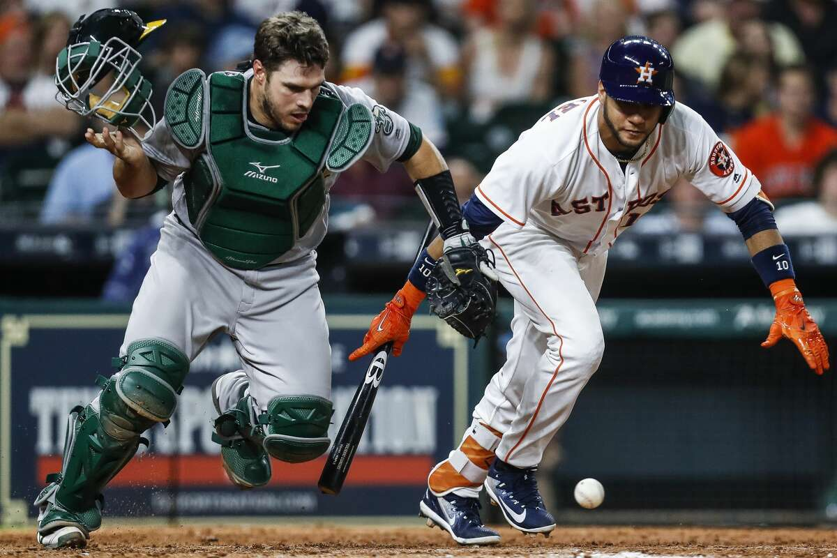 Oakland Athletics catcher Stephen Vogt (21) and Houston Astros first baseman Yuli Gurriel (10) watch as Gurriel's bunt goes foul during the ninth inning as the Houston Astros lose 2-1 to the Oakland Athletics at Minute Maid Park Saturday, April 29, 2017 in Houston. ( Michael Ciaglo / Houston Chronicle)