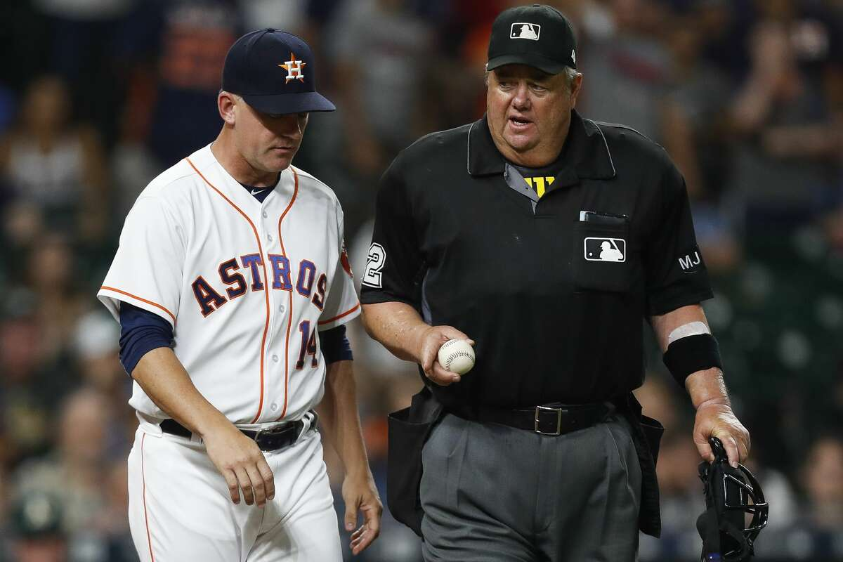 Houston Astros manager A.J. Hinch (14) talks to an umpire to challenge a call during the ninth inning as the Houston Astros lose 2-1 to the Oakland Athletics at Minute Maid Park Saturday, April 29, 2017 in Houston. The call was overturned to keep a runner on first. ( Michael Ciaglo / Houston Chronicle)