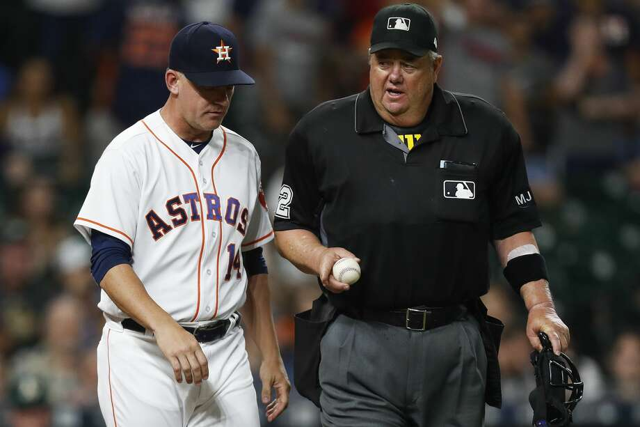 Houston Astros manager A.J. Hinch (14) talks to an umpire to challenge a call during the ninth inning as the Houston Astros lose 2-1 to the Oakland Athletics at Minute Maid Park Saturday, April 29, 2017 in Houston. The call was overturned to keep a runner on first. ( Michael Ciaglo / Houston Chronicle) Photo: Michael Ciaglo/Houston Chronicle