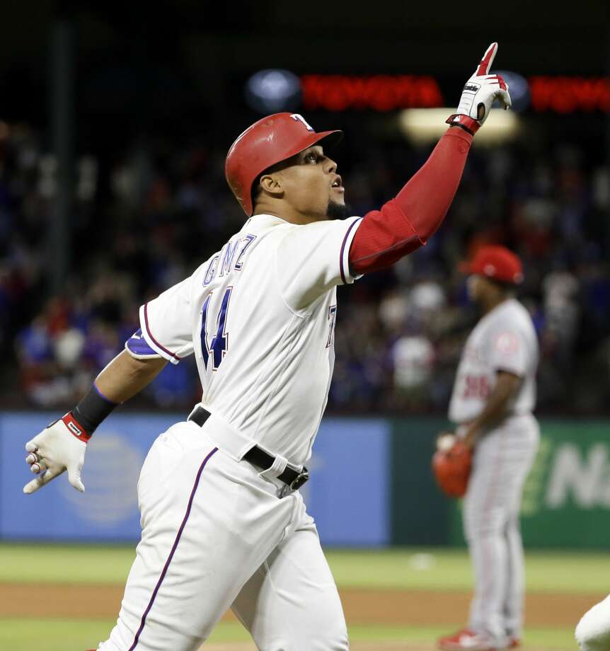 Texas Rangers' Carlos Gomez points skyward as he approaches the plate after hitting a two-run home run off of Los Angeles Angels relief pitcher Jose Valdez, rear, during the seventh inning of a baseball game in Arlington, Texas, Saturday, April 29, 2017. Gomez hit for the cycle. (AP Photo/Tony Gutierrez) Photo: Tony Gutierrez/Associated Press